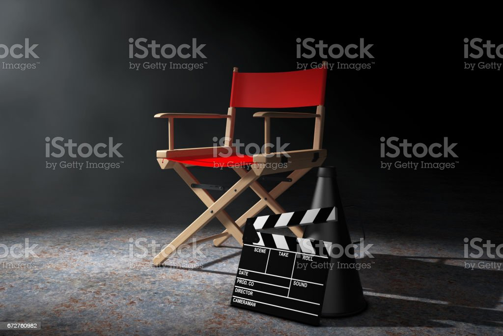 Cinema Industry Concept. Red Director Chair, Movie Clapper and Megaphone in the volumetric light. 3d Rendering stock photo