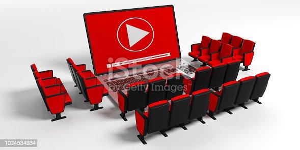 istock Cinema movie clapper board on a laptop screen. cinema chairs around, white background. 3d illustration 1024534934