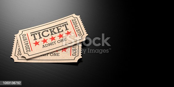 istock Cinema old type tickets beige isolated recycle, with copy space, on a black wooden background, 3d illustration. 1053136752