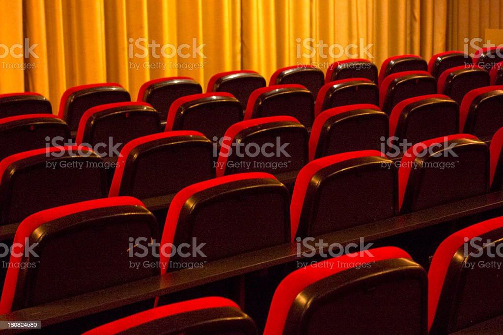 Cinema or theater seats with curtain - no people stock photo