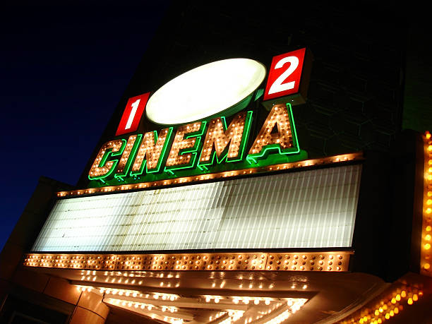 Cinema Sign Blank Old cinema sign at night with name area and marquee left blank. theater marquee commercial sign stock pictures, royalty-free photos & images