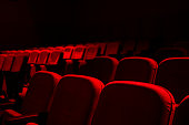 istock Cinema / theater red seats background 1197165759