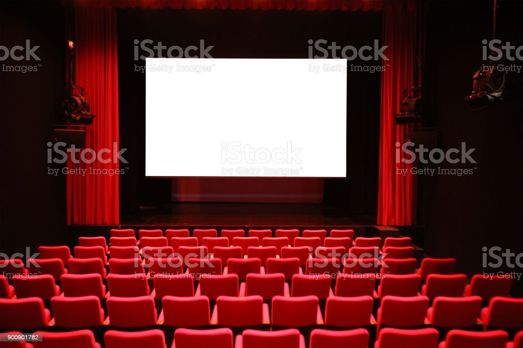 Cinema with Red Seats and Blank Screen stock photo