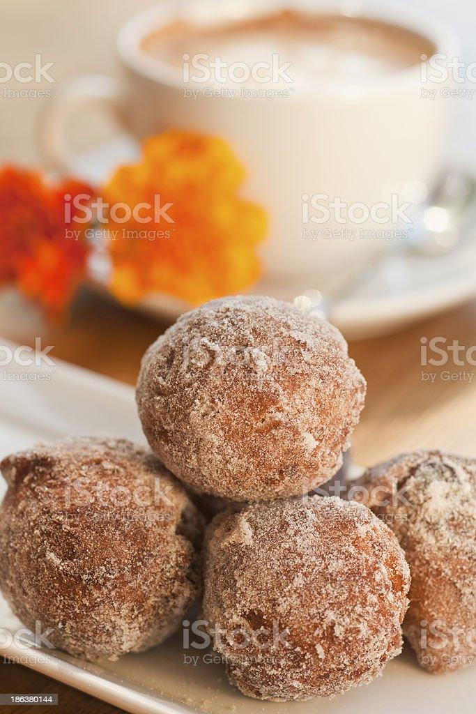 cinnamon and golden raisin beignets stock photo