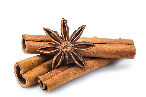Cinnamon and star anise Cinnamon sticks and star anise isolated over a white background star anise on white stock pictures, royalty-free photos & images