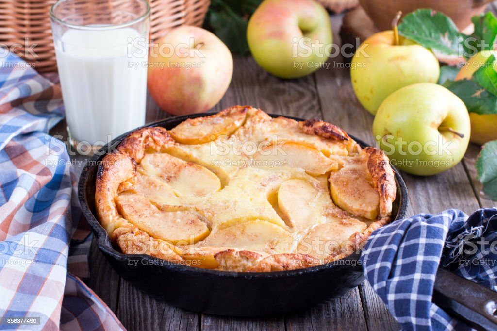 Cinnamon Apple Dutch Baby Pancake in iron pan. Style rustic. Selective focus stock photo