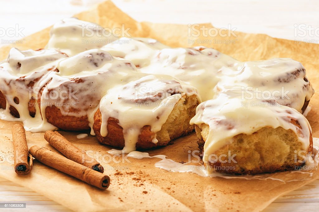 Cinnamon buns glazed with cream cheese. stock photo