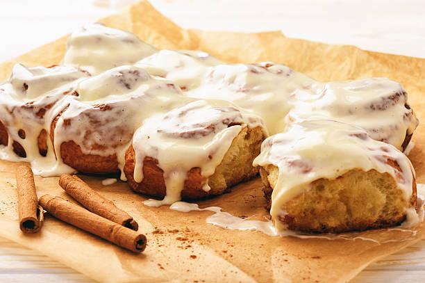 Cinnamon buns glazed with cream cheese. stock photo