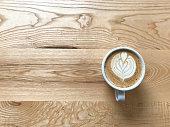 cinnamon coffee on wood background