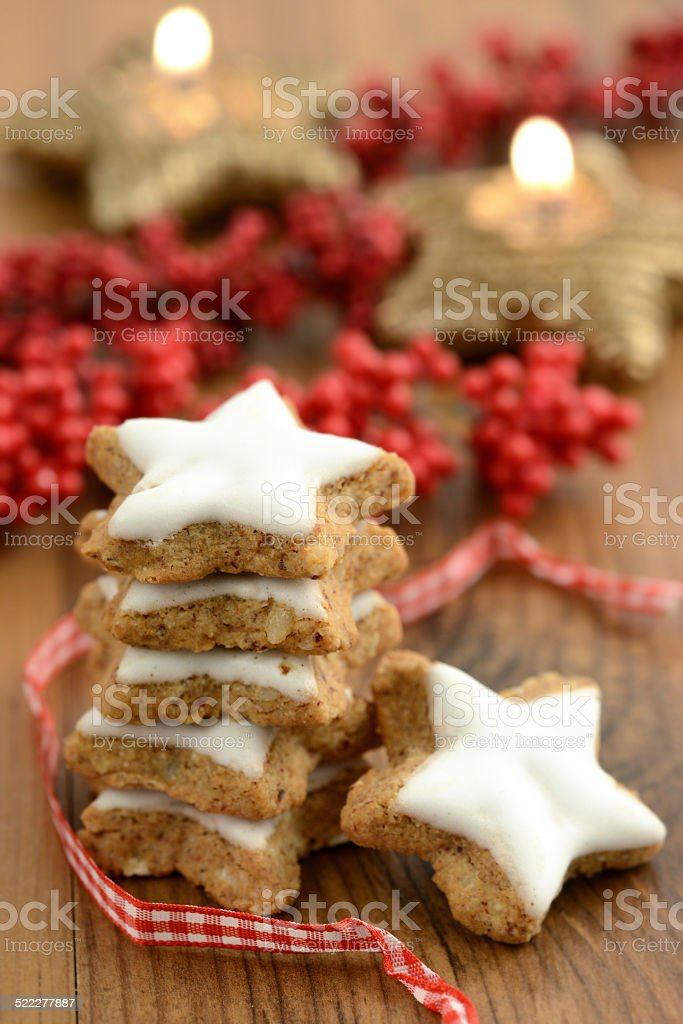 cinnamon cookies in star shape with christmas balls stock photo