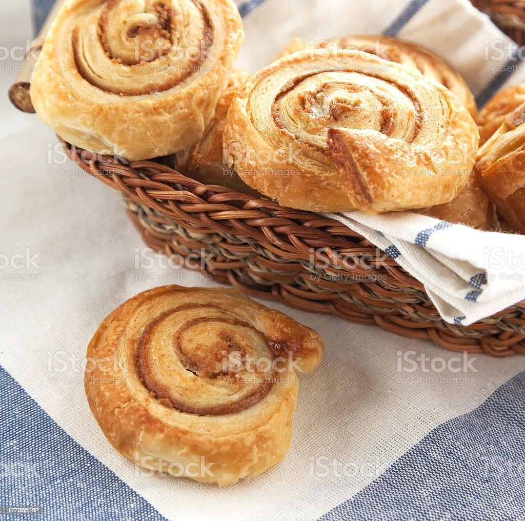 Cinnamon danish bun in the basket royalty-free stock photo