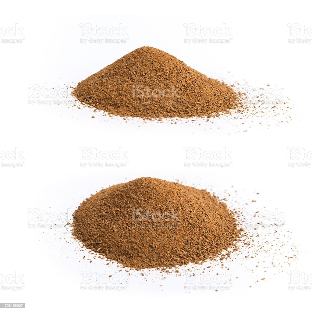 Cinnamon heap isolated on white stock photo