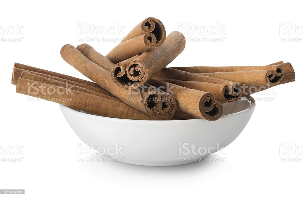 Cinnamon in a plate royalty-free stock photo
