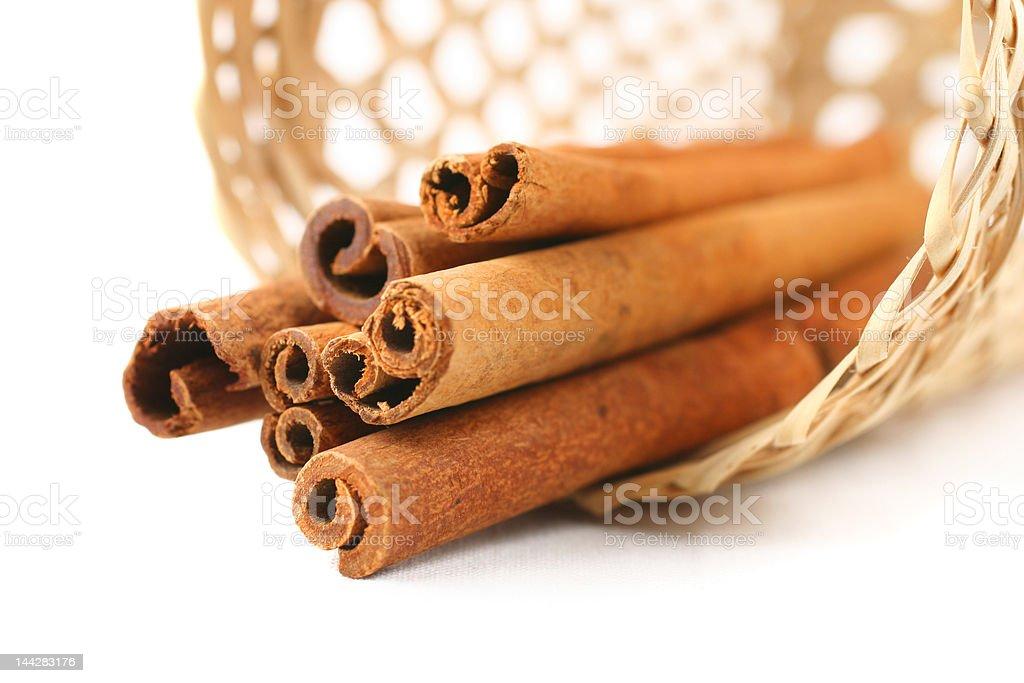 cinnamon in basket on white royalty-free stock photo