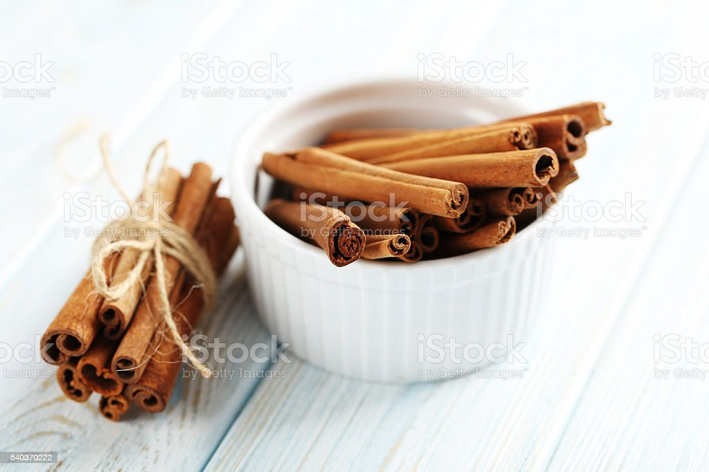Cinnamon on a blue wooden background stock photo