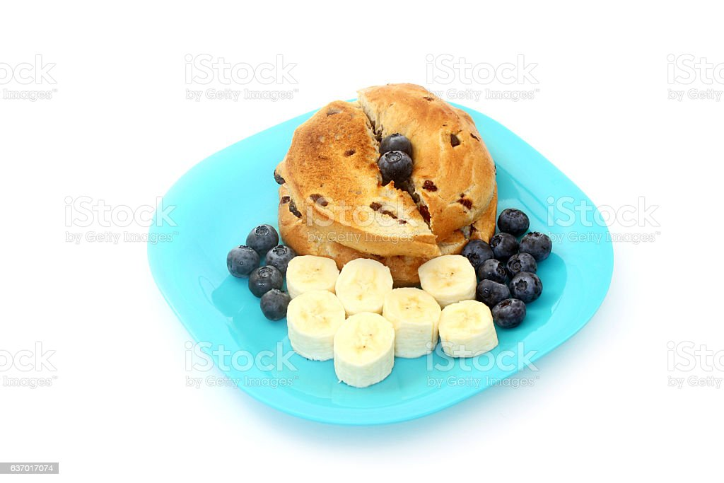 Cinnamon Raisin Bagel With Bananas and Blueberries stock photo