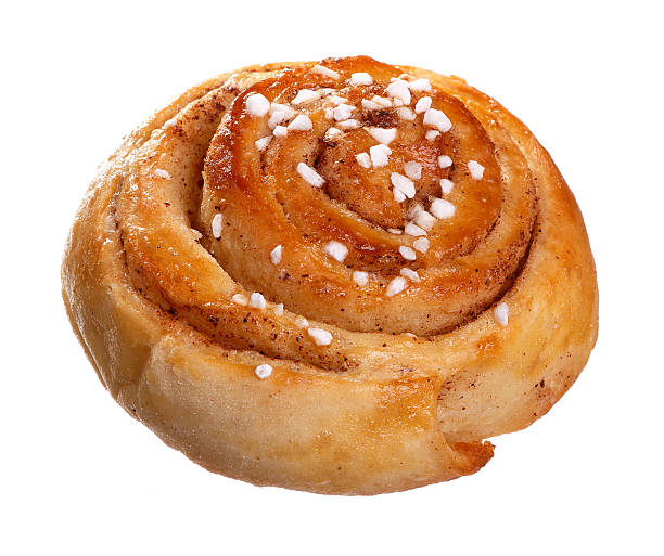 Cinnamon roll on white One cinnamon roll isolated on white background. sweet bun stock pictures, royalty-free photos & images