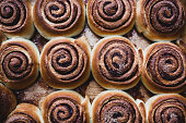 istock Cinnamon rolls on a tray after baking 869617492