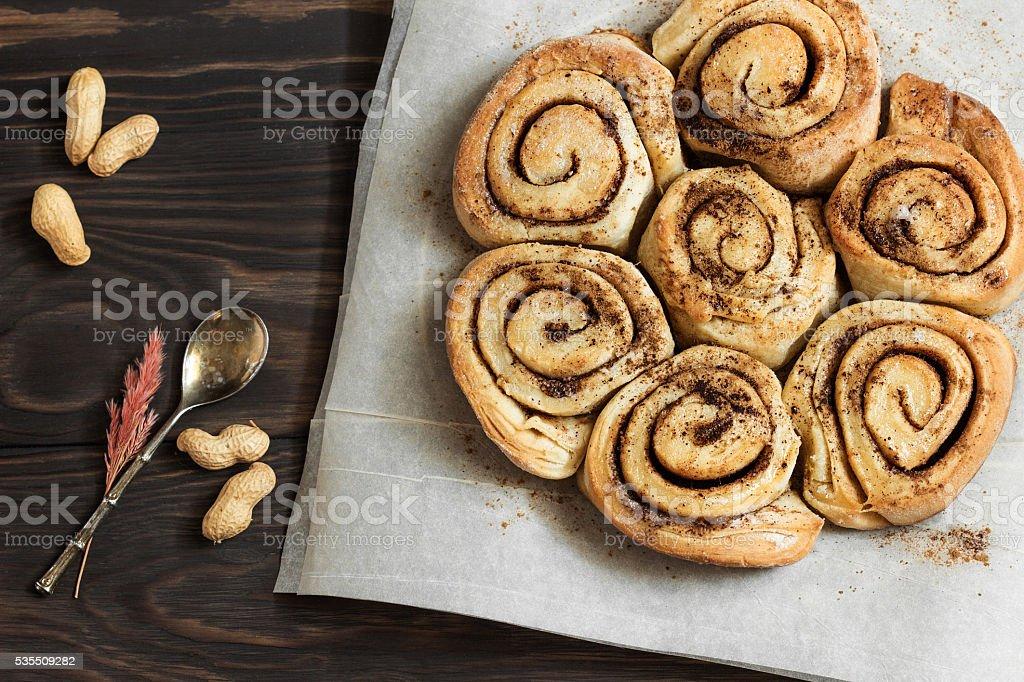 cinnamon rolls  on a wooden breakfast table stock photo