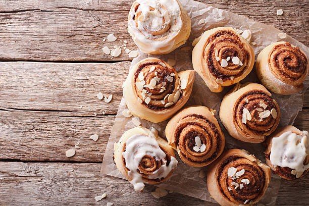 cinnamon rolls on the table. horizontal top view - sticky stock pictures, royalty-free photos & images