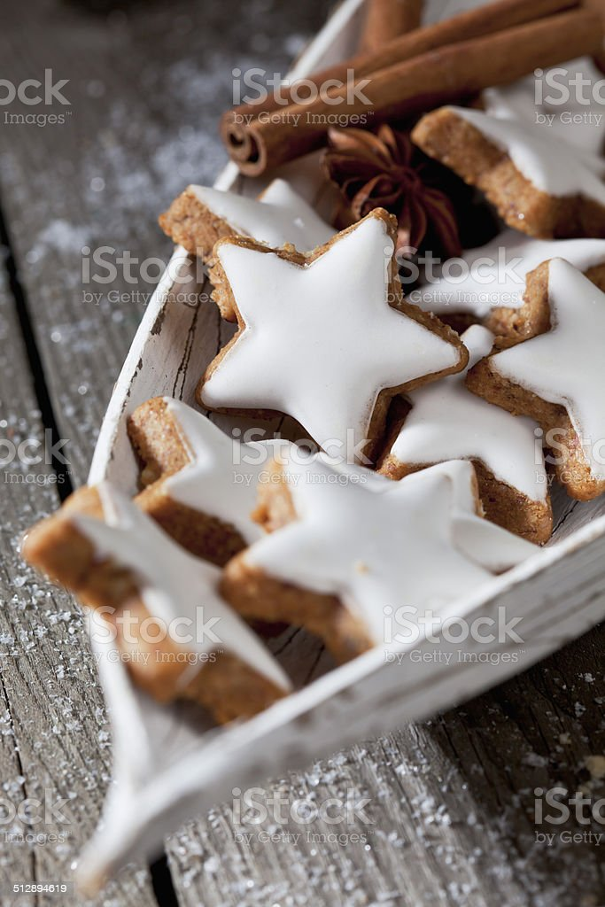 Cinnamon stars in wooden bowl stock photo