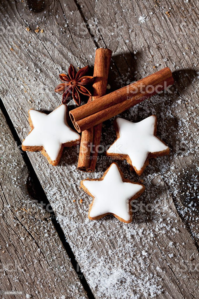 Cinnamon stars with spices on wooden background stock photo