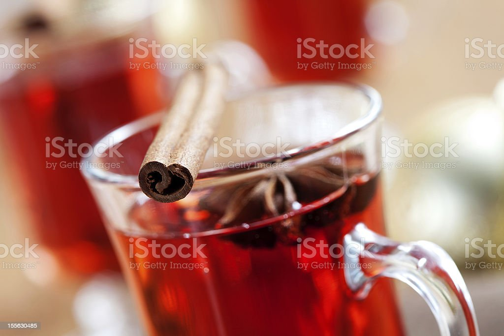 Cinnamon stick a top a glass filled with red liquid royalty-free stock photo