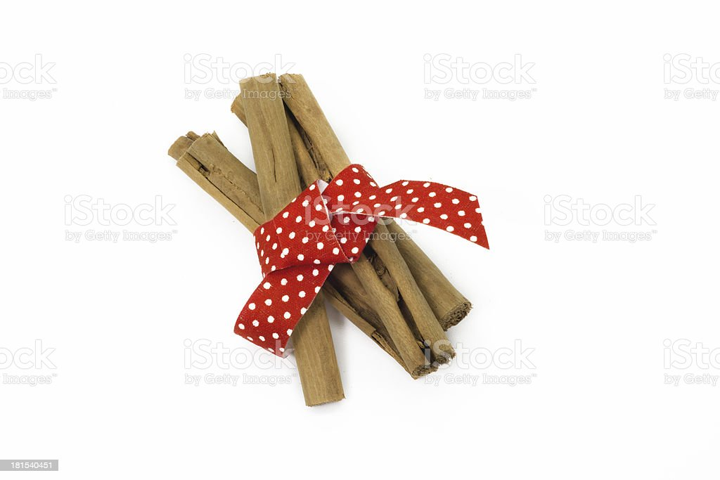 cinnamon stick and red riboon royalty-free stock photo