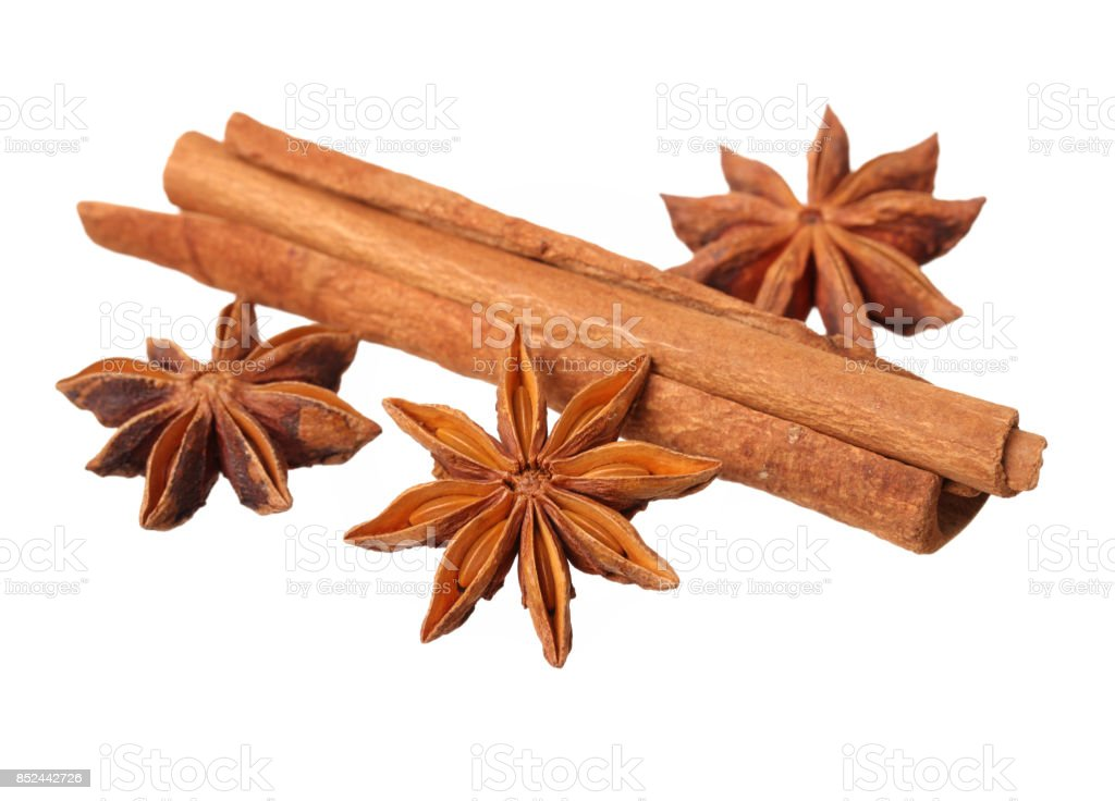 Cinnamon stick and star anise spice isolated on white background closeup stock photo