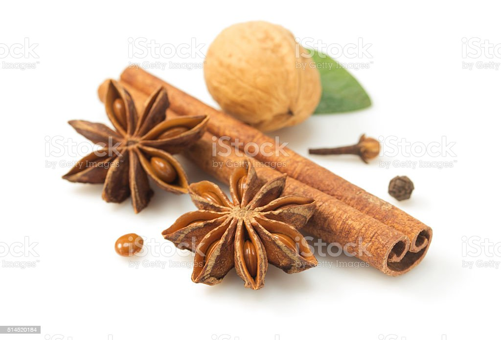 cinnamon sticks and anise star on white stock photo