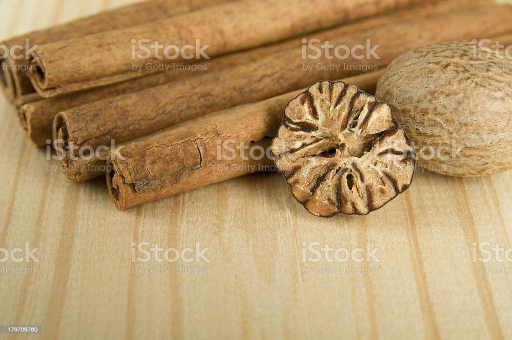 Cinnamon sticks and nutmeg royalty-free stock photo