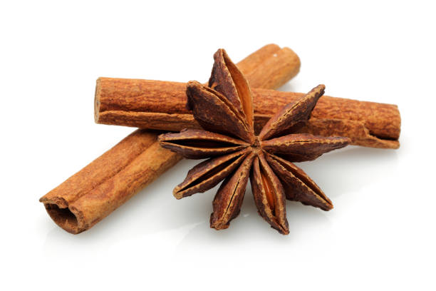 Cinnamon sticks and star anise isolated on white background Cinnamon sticks and star anise isolated on white background star anise on white stock pictures, royalty-free photos & images