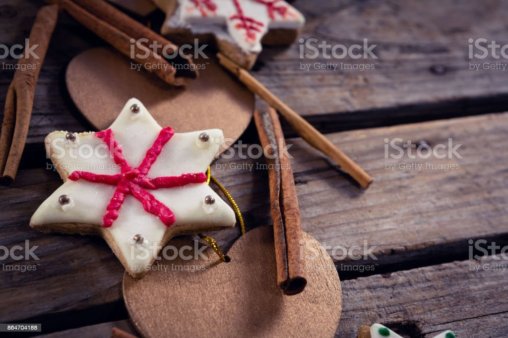 Cinnamon Sticks Cookies And Christmas Decoration On Wooden Plank