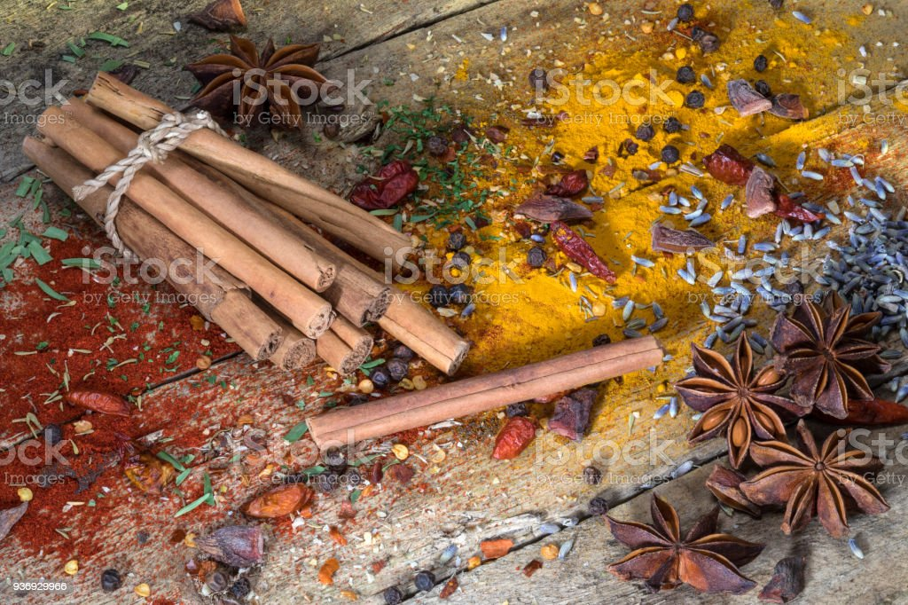 Cinnamon Sticks Herbs And Spices On A Rustic Farmhouse Table