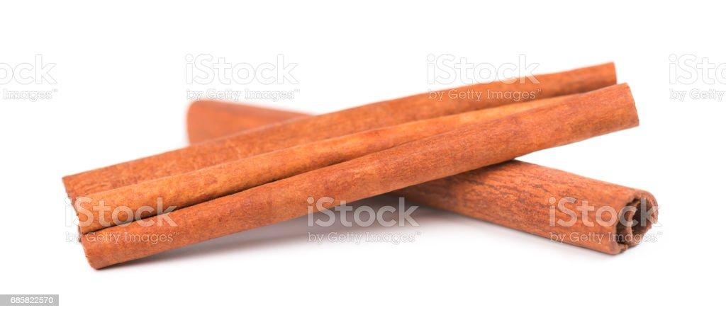 Cinnamon sticks isolated on white background stock photo