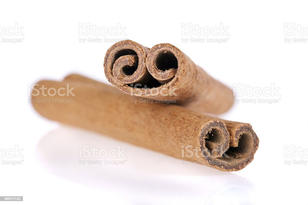 Cinnamon sticks isolated on white royalty-free stock photo