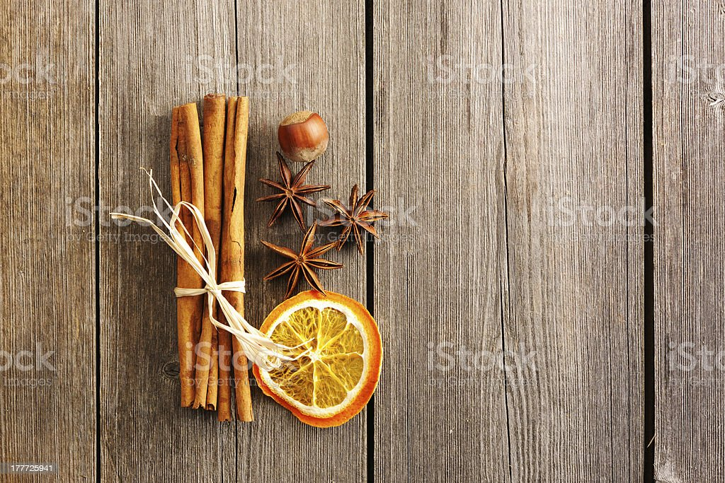 Cinnamon sticks over wooden table royalty-free stock photo