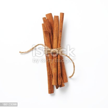 a group of 7 cinnamon sticks tied with twine