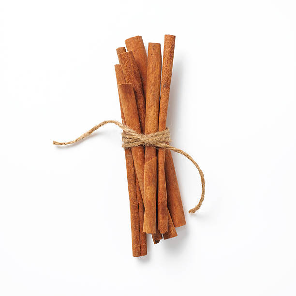 cinnamon sticks a group of 7 cinnamon sticks tied with twine bundle stock pictures, royalty-free photos & images
