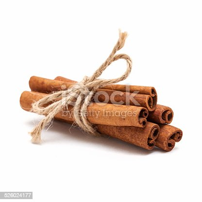 Five cinnamon sticks tied by rope isolated on white background.