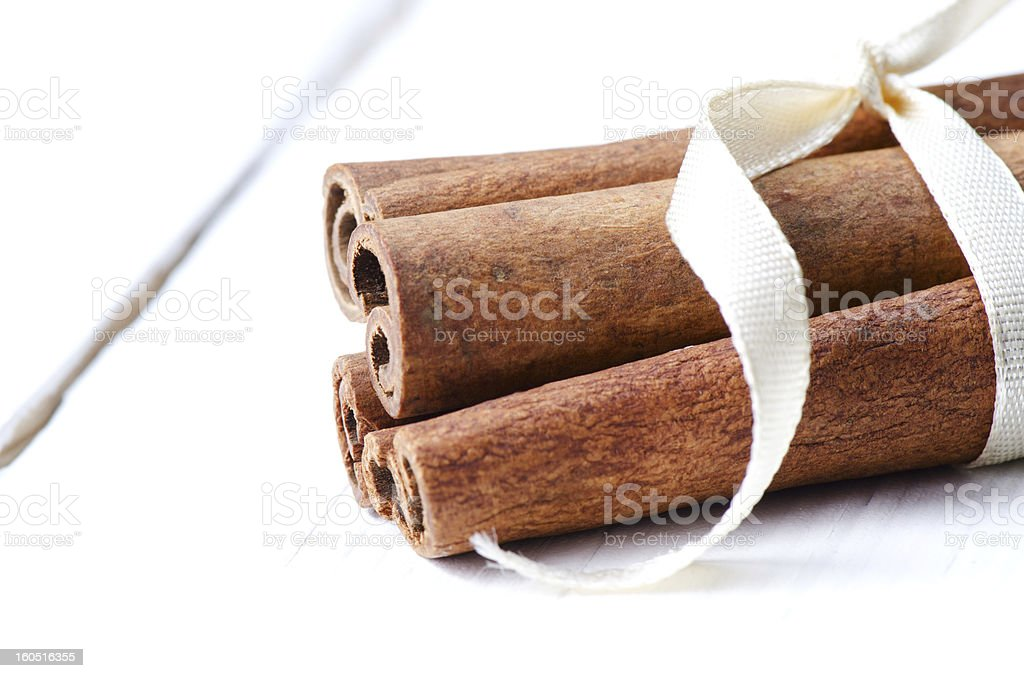 Cinnamon sticks tied up with ribbon royalty-free stock photo