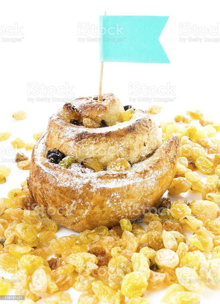 Cinnamon sweet bun with Raisins, Powdered Sugar royalty-free stock photo
