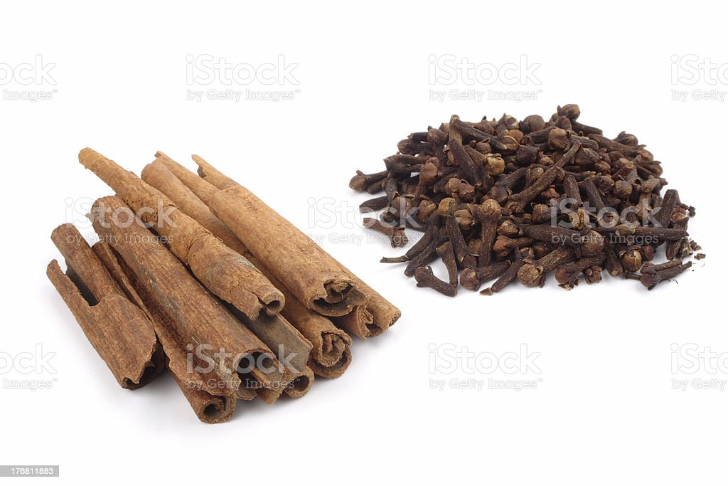 Cinnamons and cloves royalty-free stock photo
