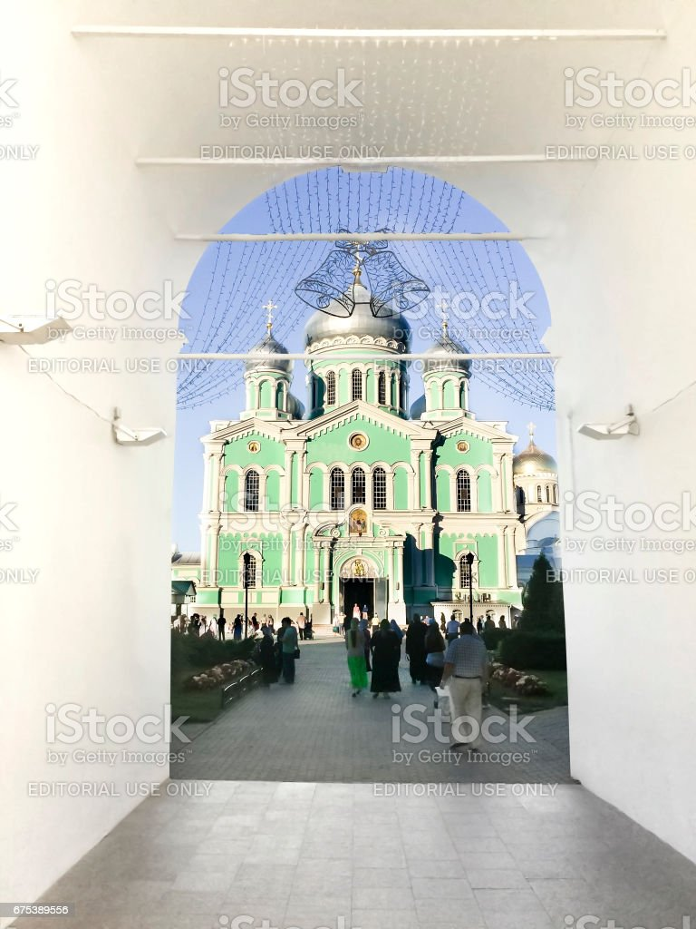 DIVEEVO, RUSSIA - circa AUGUST, 2016: Unknown pilgrims go to morning Divine Liturgy at Trinity Cathedral of Holy Trinity Seraphim-Diveevo nunnery in village Diveevo, Nizhny Novgorod region, Russia stock photo
