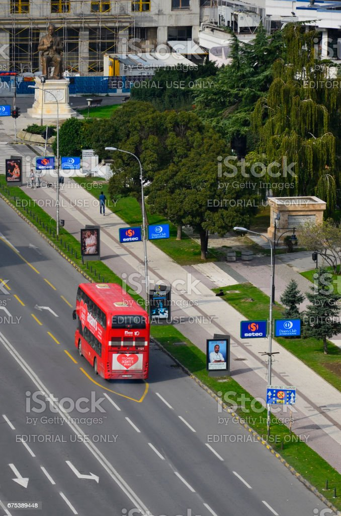 SKOPJE, MACEDONIA - circa OCT, 2015: Double decker bus specially designed for Skopje public transportation, aerial stock photo
