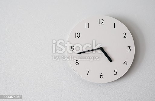 istock circle clock on white background wall. 1000874932