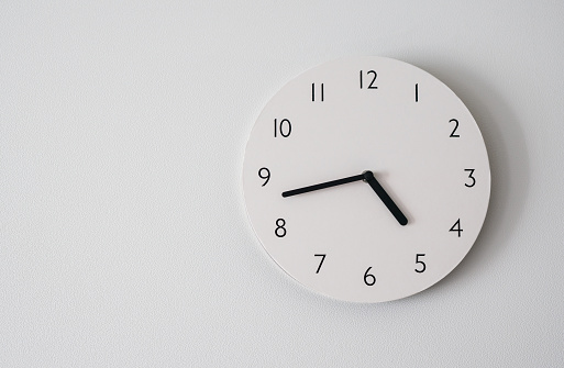circle clock on white background wall.