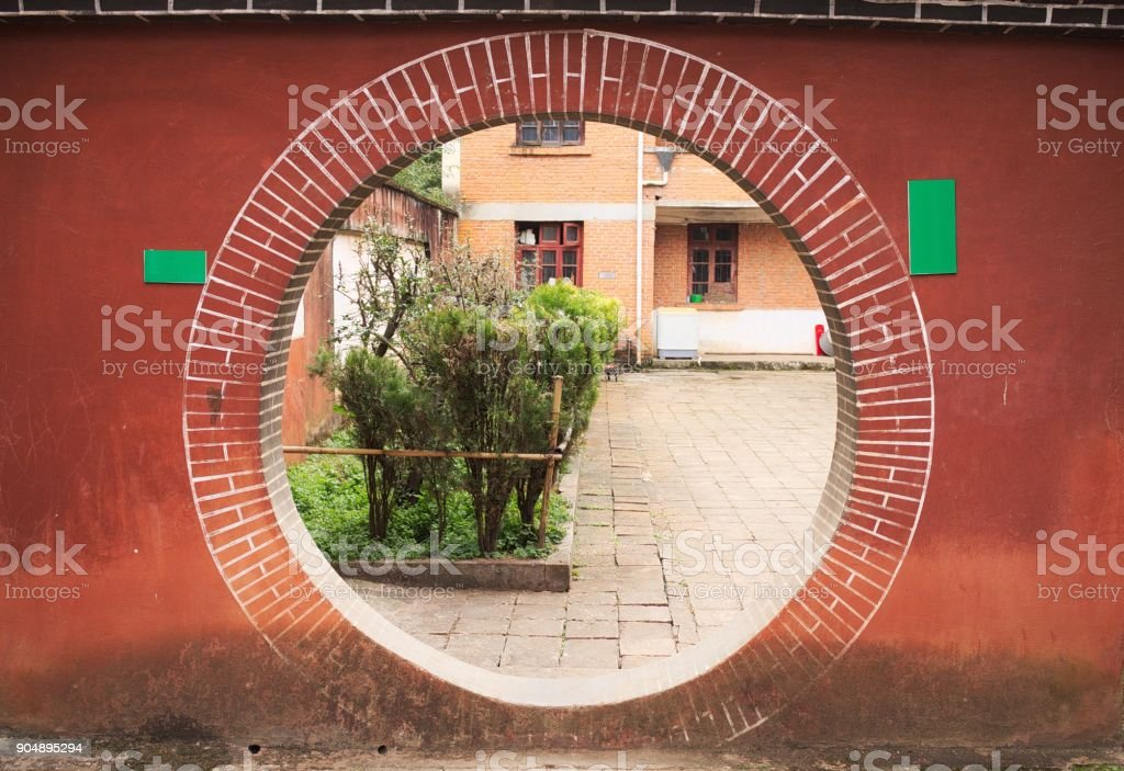 Circle - Hole in the wall - Brick wall - Garden (Kunming, Yunnan, China) stock photo