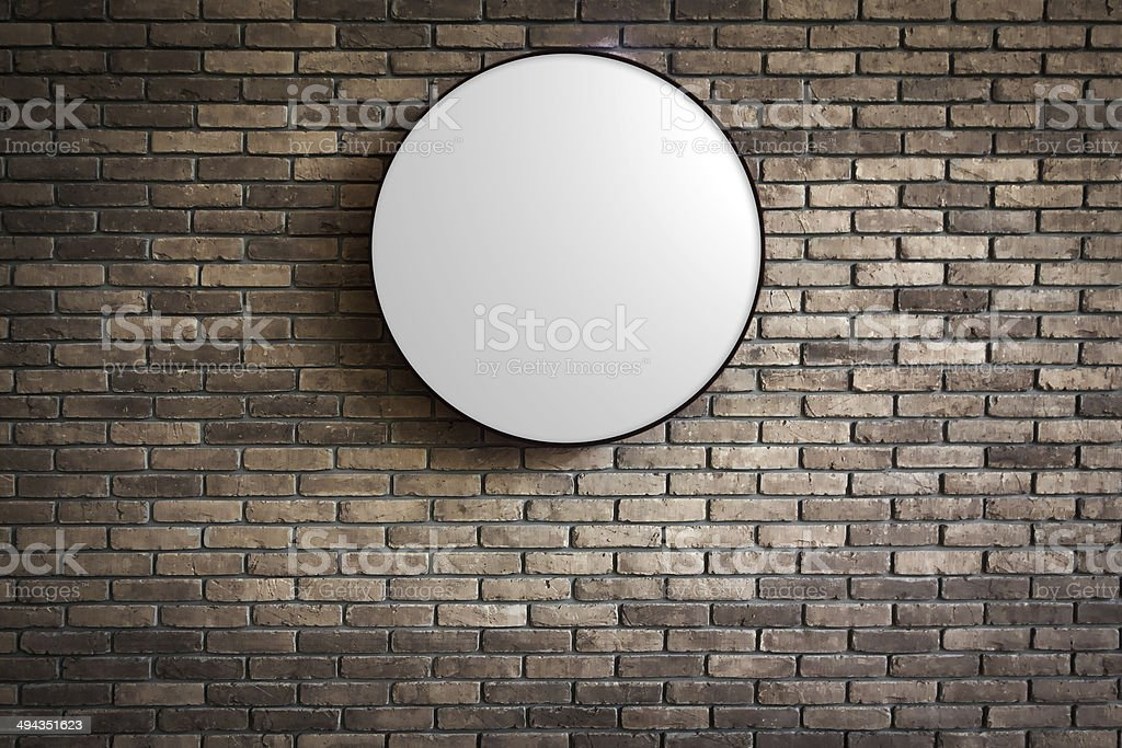 Circle Lightbox logo on the dark red brick wall stock photo