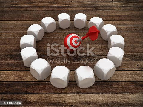 istock Circle of Blocks with Target and Dart on Wood Floor - 3D Rendering 1044860630